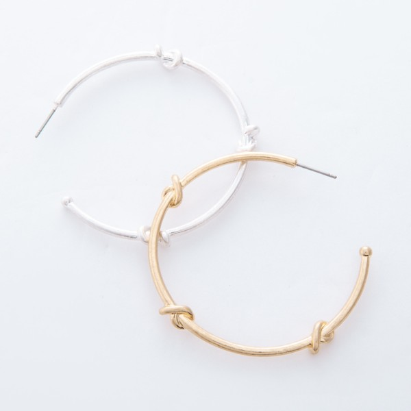 "Worn Gold knotted hoop earrings.  - Approximately 2"" in diameter"
