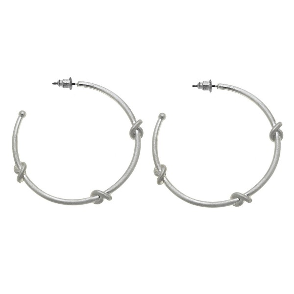 "Worn Silver knotted hoop earrings.  - Approximately 2"" in diameter"