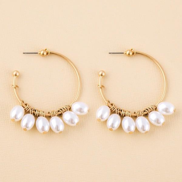 "Gold pearl beaded dangle hoop earrings.  - Approximately 2"" L  - 2"" in diameter"