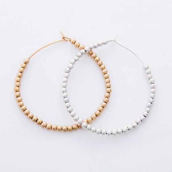 """Worn Gold Sphere Beaded Hoop Earrings.  - Hook closure - Approximately 2"""" in diameter"""