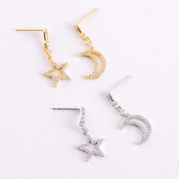 "Gold dipped cubic zirconia mix match star and moon dangle earrings.  - Cubic Zirconia  - Approximately 1"" in length"