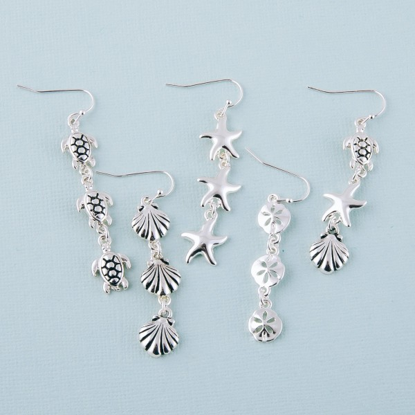 """Silver sea life drop earrings.  - Approximately 2"""" in length"""