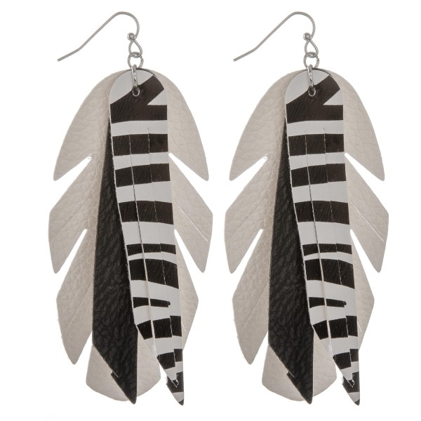 "Faux leather zebra print feather tassel statement earrings.  - Approximately 4"" in length"