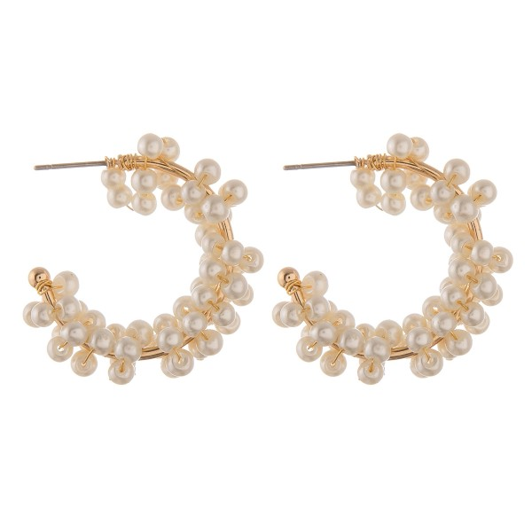 "Pearl beaded open hoop earrings.  - Approximately 1"" in diameter"