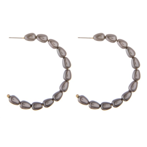 "Pearl beaded open hoop earrings.  - Approximately 2"" in diameter"