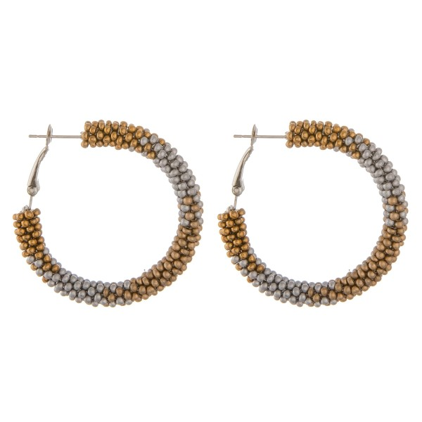 "Graduate print pattern seed beaded hoop earrings.  - Approximately 1.5"" in diameter"