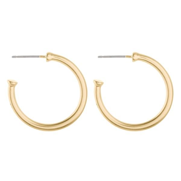 """Short metal hoop earrings.  - Approximately 1"""" in diameter"""