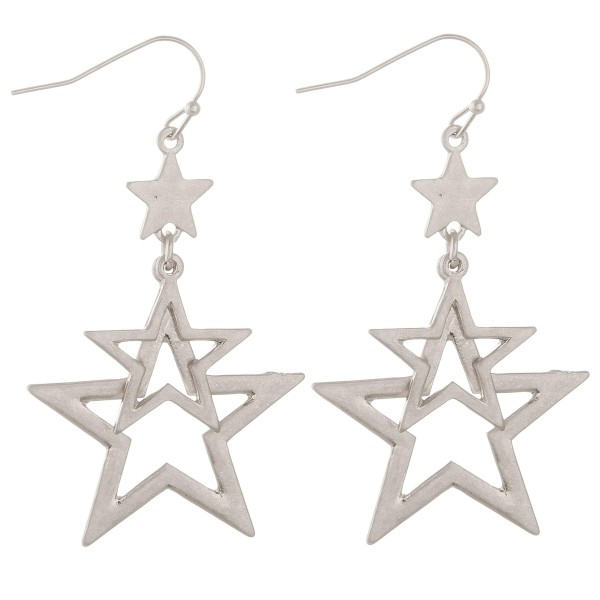 "Metal cut out star dangle earrings.  - Approximately 2.5"" L"