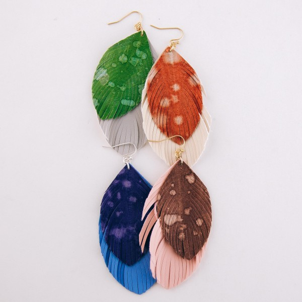 "Faux leather water spot layered feather statement earrings.  - Approximately 4"" L"