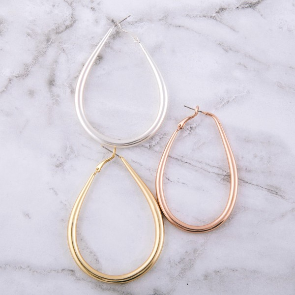"Large teardrop hoop earrings.  - Approximately 2.75"" L"