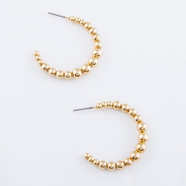 "Metal Tone Ball Beaded Open Hoop Earrings.  - Approximately 1.25"" in diameter"