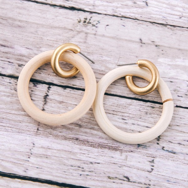 "Wood disc huggie hoop earrings.  - Approximately 1.5"" L  - 1.5"" in diameter"