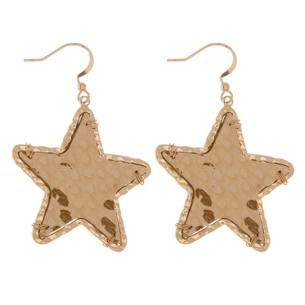 "Metallic faux leather snakeskin star drop earrings with Gold textured trim.  - Approximately 2"" L"