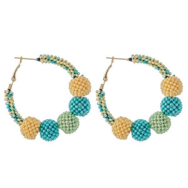 "Mint multicolored seed beaded statement hoop earrings with ball beads.  - Approximately 2"" in diameter - Bead size 17mm"