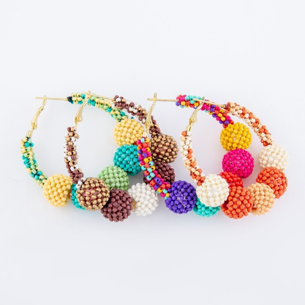"Natural multicolored seed beaded statement hoop earrings with ball beads.  - Approximately 2"" in diameter - Bead size 17mm"