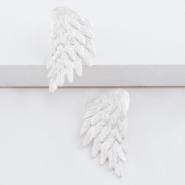 """Metal angel wing drop earrings.  - Approximately 1.5"""" L"""