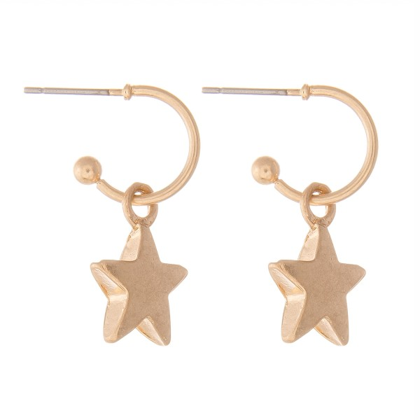 "Star Huggie Hoop Earrings in Worn Gold.  - Approximately 1"" L - Hoop 1cm in diameter"