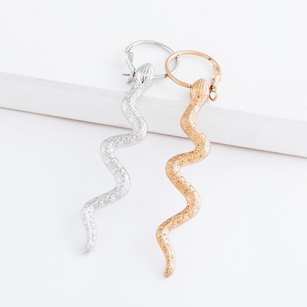 "Designer inspired snake hoop earrings.  - Approximately 3.5"" L - .75"" in hoop diameter"