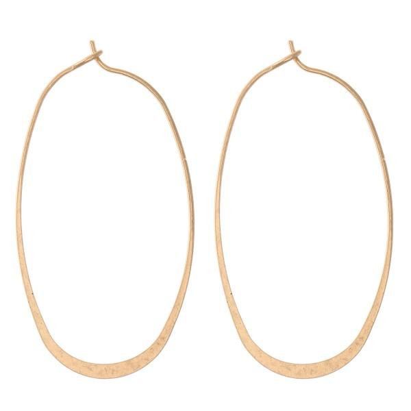 "Flat Oval Hoop Earrings.  - Hook closure - Approximately 2.5"" L"