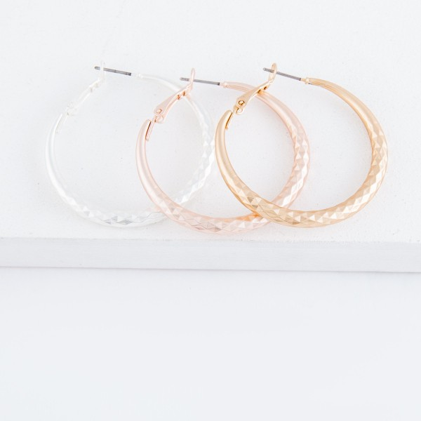 "Diamond cut textured matte hoop earrings.  - Approximately 1.5"" in diameter"