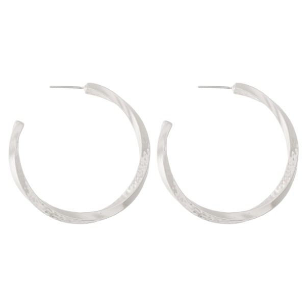 "Metal hoop earrings with swirl design and hammered accents.  - Approximately 1.5"" L"