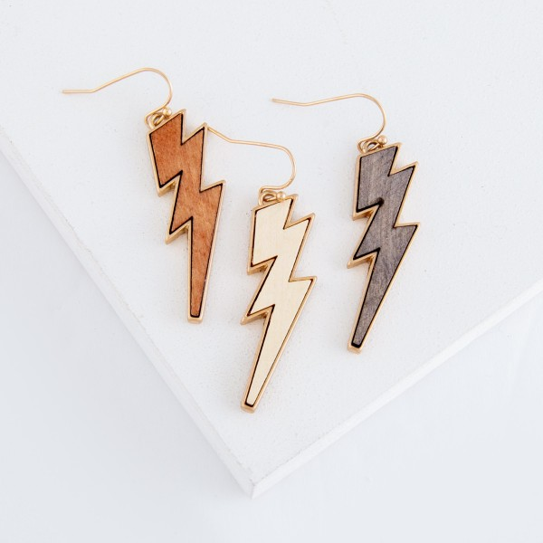 "Metal encased wooden lightning bolt drop earrings.  - Approximately 2"" L"