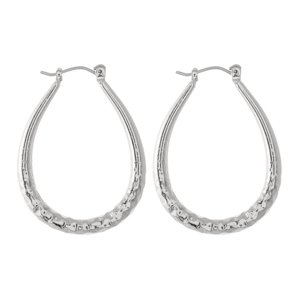 "Short oval hoop earrings featuring textured details.  - Approximately 1.5"" L"