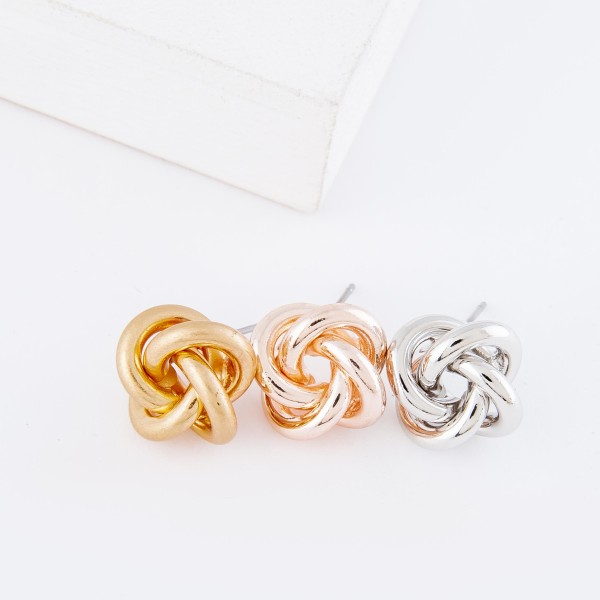 """Modern metal stud earrings featuring a knot design.  - Approximately .5"""" in diameter"""