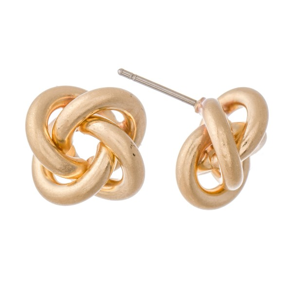 "Modern metal stud earrings featuring a knot design.  - Approximately .5"" in diameter"