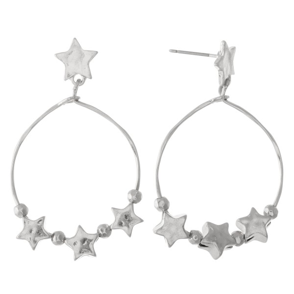 """Circular metal earrings featuring star accents.  - Approximately 1"""" in diameter"""