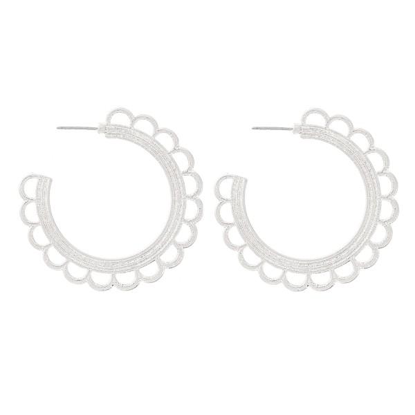 """Metal flower textured hoop earrings.  - Approximately 1.75"""" in diameter"""