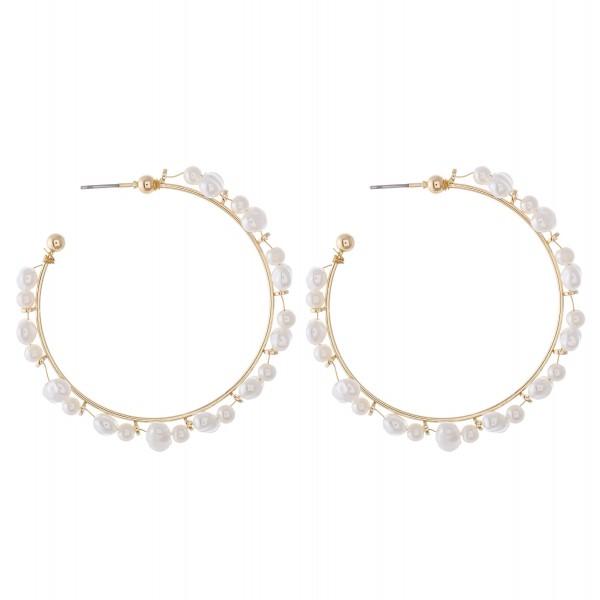 "Irregular pearl wire beaded hoop earrings.  - Pearls vary in size - Approximately 2.5"" in diameter"