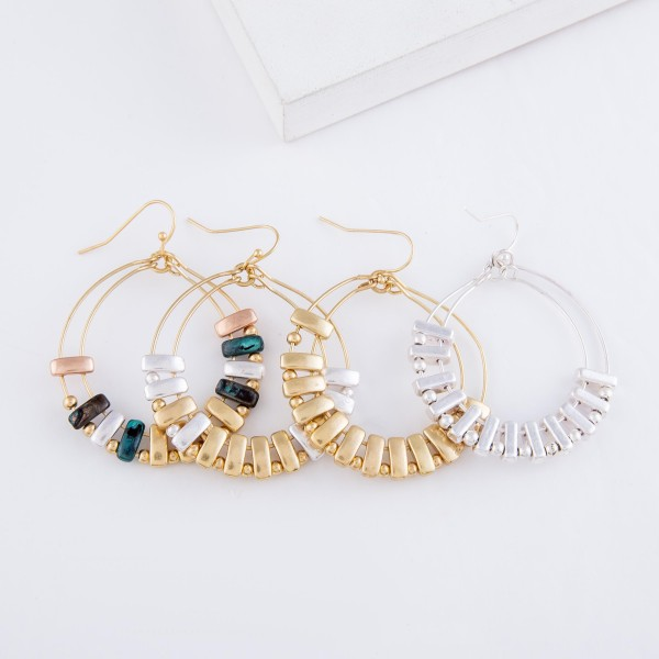 """Circular Drop Earrings Featuring Metal Tone Accents.  - Approximately 2"""" L  - 1.75"""" in diameter"""