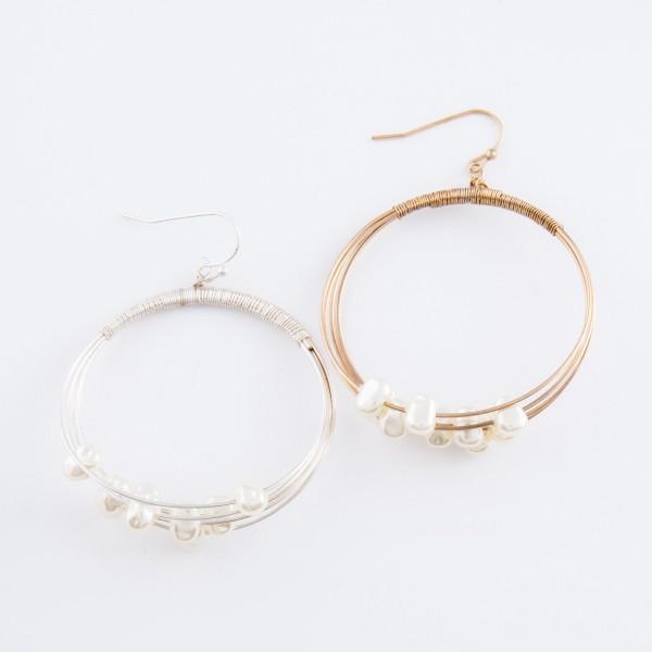 "Ivory pearl beaded wire drop earrings.  - Approximately 2.25"" L - 1.75"" in diameter"