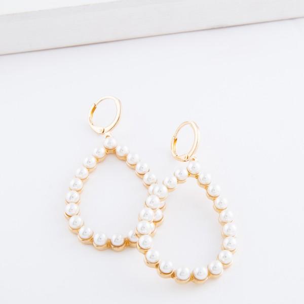 """Ivory Pearl huggie hoop teardrop earrings.  - Approximately 2.5"""" L"""