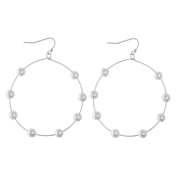 """Wire beaded drop earrings.  - Approximately 2.25"""" L - 2"""" in diameter"""