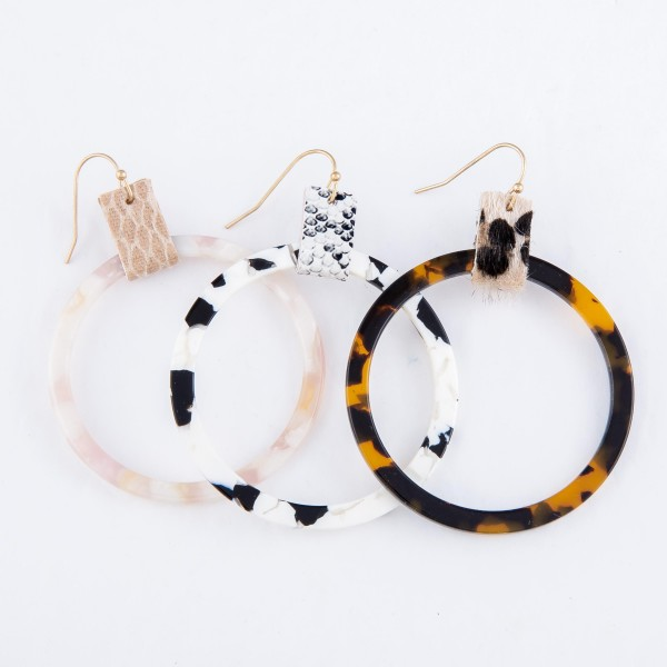 "Resin Drop Earrings Featuring Animal Print Cuff Accent.  - Approximately 2.5"" L  - Approximately 2"" in Diameter"