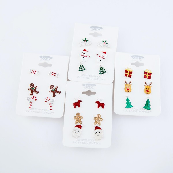 """Enamel Coated Christmas Stud Earring Set.  - 3 Pair Per Set - Features: Noel, Snowmen and Rhinestone Christmas Trees - Approximately .5"""" in Size"""