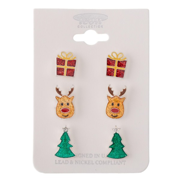 """Glittery Enamel Coated Christmas Stud Earring Set.  - 3 Pair Per Set - Features: Christmas Presents, Reindeer and Christmas Trees  - Approximately .5"""" in Size"""