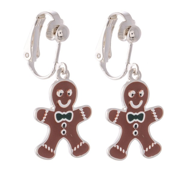 "Enamel Coated Christmas Gingerbread Clip On Earrings in Silver.  - Approximately .75"" in Size"