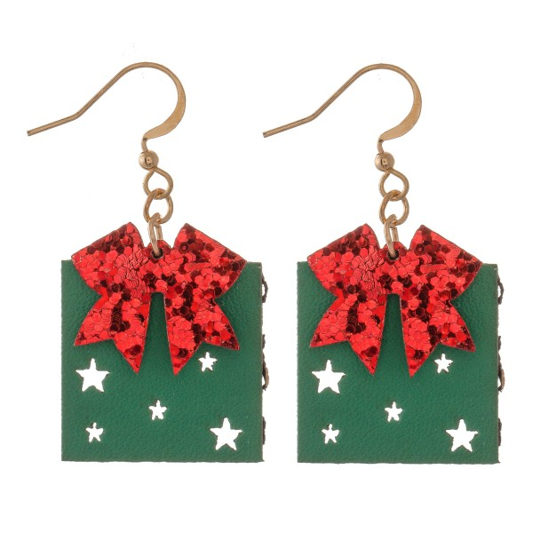 "Two Tone Glitter Christmas Present Drop Earrings Featuring Star Punch Out Details.  - Faux Leather  - Approximately 1.5"" L"