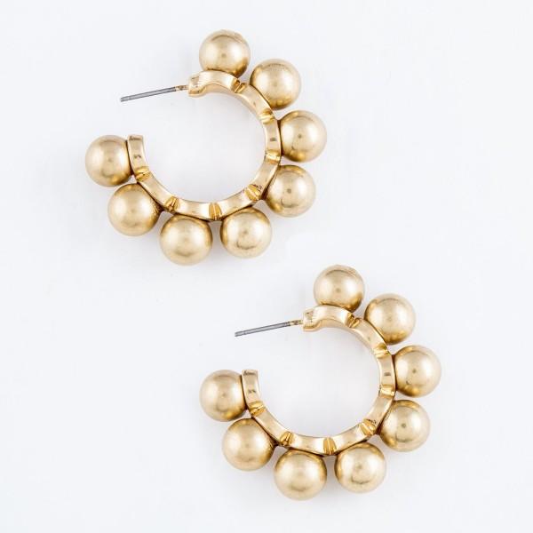 """Ball Stud Hoop Earrings in Worn Gold.  - Hoop Diameter 1""""  - Ball Bead Size 7mm"""