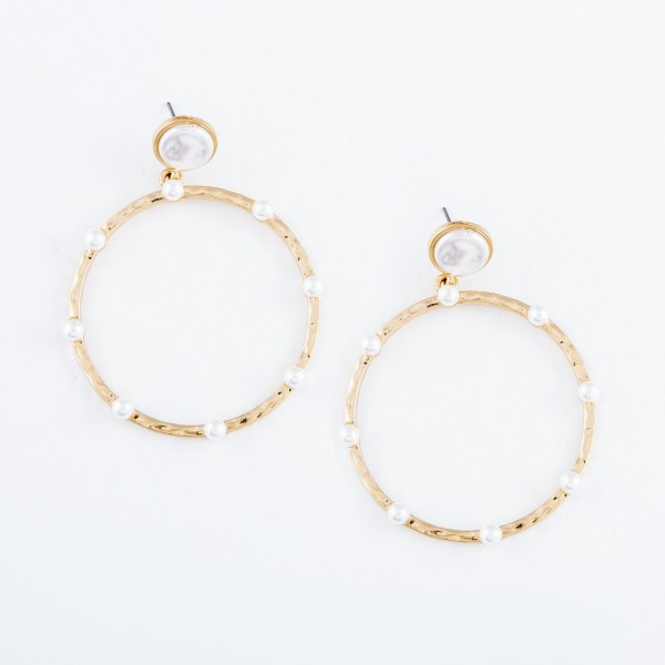 "Hammered Drop Earrings in Gold Featuring Ivory Pearl Accents.  - Diameter 2""  - Approximately 2.5"" L"