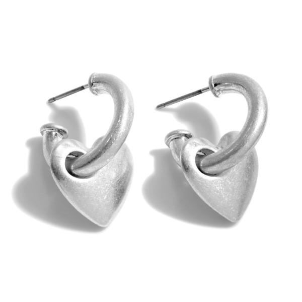 """Heart Huggie Hoop Earrings in a Worn Finish.  - Approximately .75"""" in Hoop Diameter - Approximately 1"""" in Length"""