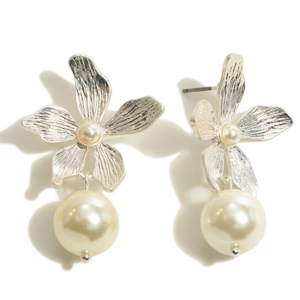 "Metal Flower Drop Pearl Earrings in a Worn Finish.  - Pearl 11mm in Diameter - Flower approximately 1'  - Approximately 1.5"" in Length"