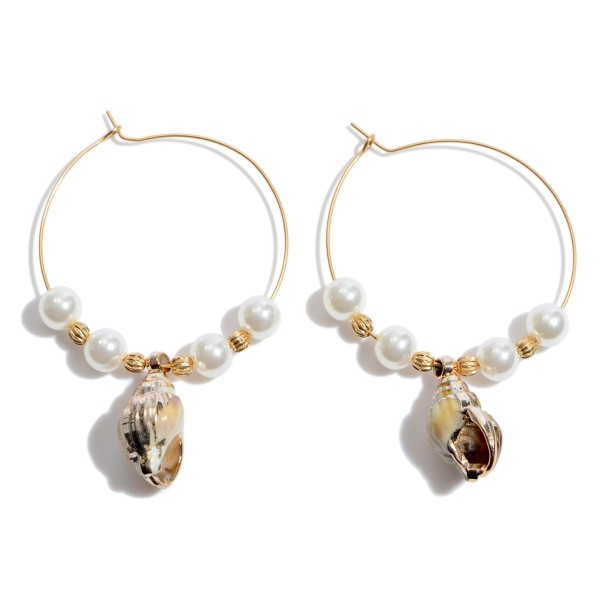 "Ivory Pearl Beaded Wire Hoop Earrings Featuring Seashell Drop Accent.  - Seashell .75""  - Approximately 2"" x 2.5"""