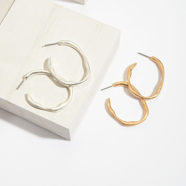 "Hammered Metal Hoop Earrings in a Worn Finish.  - Approximately 1.5"" in Length"