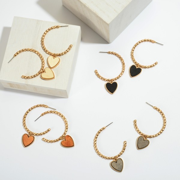 "Beaded Hoop Earrings in Gold Featuring a Wood Heart Detail.  - Heart .75""  - Hoop Diameter 1.5""  - Approximately 2"" in Length"