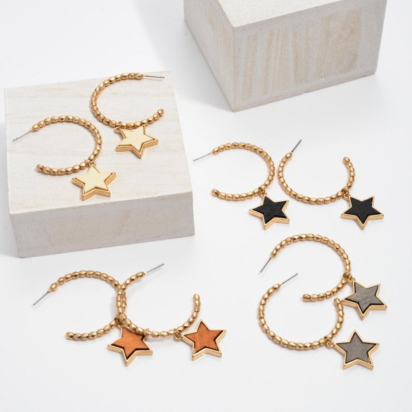 "Beaded Hoop Earrings in Gold Featuring a Wooden Star Accent.  - Star .75""  - Hoop Diameter 1.5'  - Approximately 2"" in Length"