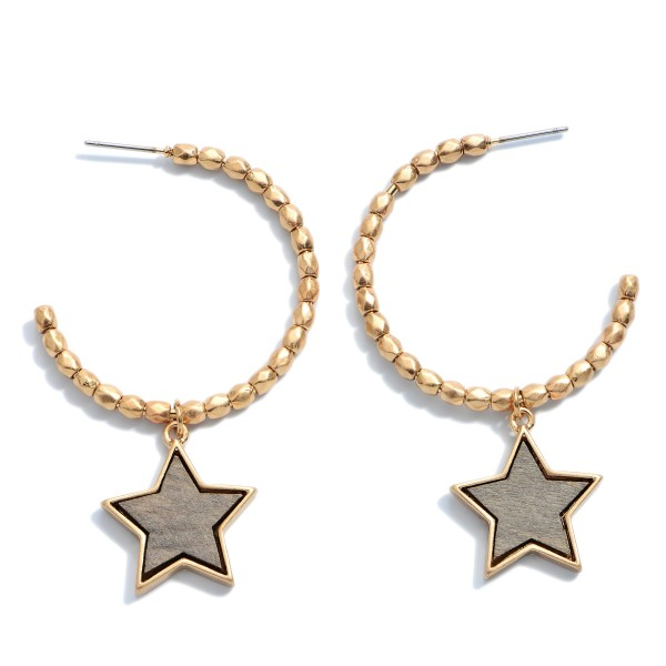 """Beaded Hoop Earrings in Gold Featuring a Wooden Star Accent.  - Star .75""""  - Hoop Diameter 1.5'  - Approximately 2"""" in Length"""